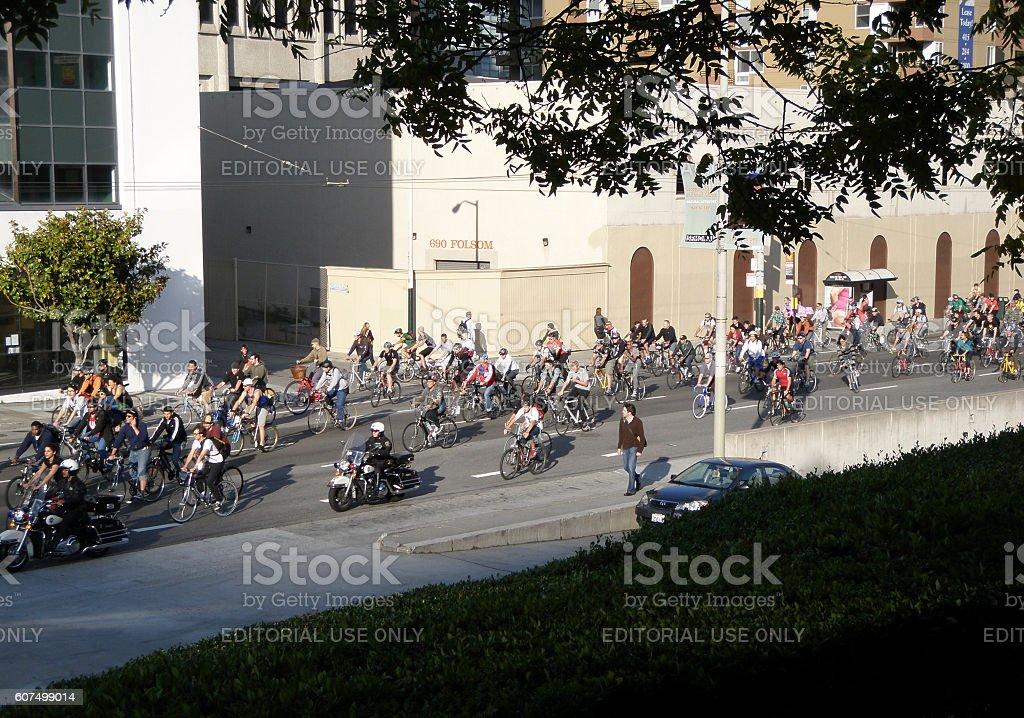 Critcal Mass bikers travel down 3rd street in mass stock photo