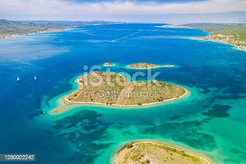 istock Croatia, beautiful coastline on Adriatic sea, romantic heart shaped island of Galesnjak in turquoise sea 1250022242