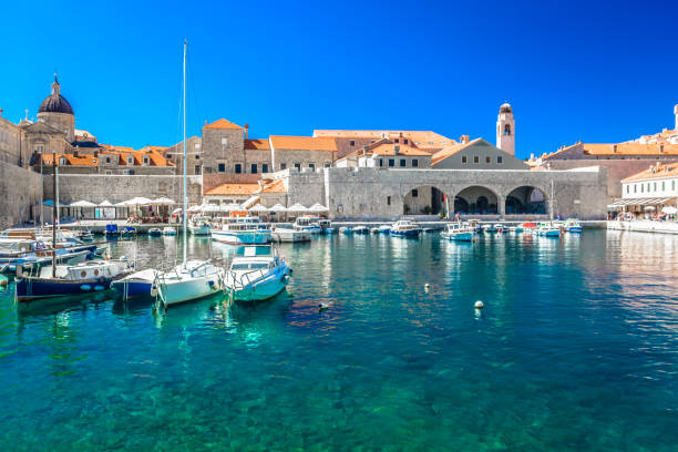 Croatia Dubrovnik waterfront view. Waterfront view at sea port in Dubrovnik old town, famous european tourist resort in Europe, Southern Croatia. croatian culture stock pictures, royalty-free photos & images