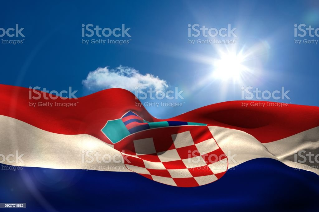 Croatia national flag under sunny sky - foto stock