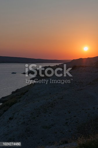 istock Croatia: panoramic view at sunset from the road on the island of Pag, the fifth-largest island of the Croatian coast in the northern Adriatic Sea 1024274450