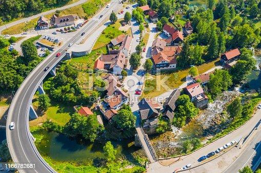Croatia, Rastoke, village near Slunj in Croatia, old water mills on waterfalls of Korana river, beautiful countryside landscape, aerial drone shot