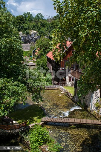 Rastoke, Croatia, Europe - June 26, 2018: view of Rastoke, the historic center of the municipality of Slunj known as the Small Lakes of Plitvice, with its wooden houses, water mills and waterfalls into the Korana river