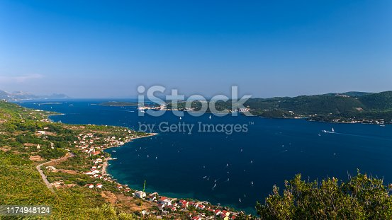 View from the hill to the Croatian coast. Kuciste, Viganj and Korcula area. The sea is full of sailboats, winderfers, kayteserfers and motorboats. Summer in Croatia. HDR photo.