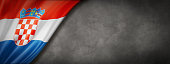 istock Croatian flag on concrete wall banner 1227097903