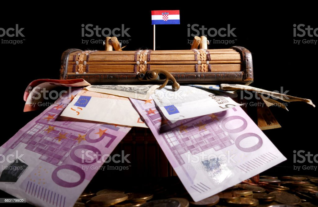 Croatian flag on top of crate full of money stock photo