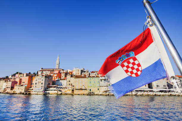 Croatian flag with Rovinj town, Croatia. Travel vacations concept Vacations in Croatia. View of Rovinj old town, Croatia croatian culture stock pictures, royalty-free photos & images