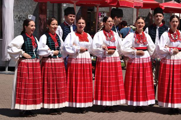 Croatian folk dance ZAGREB, CROATIA - JUNE 30, 2019: Croatian folk dancers perform in traditional costumes at a public square in Zagreb, capital city of Croatia. croatian culture stock pictures, royalty-free photos & images