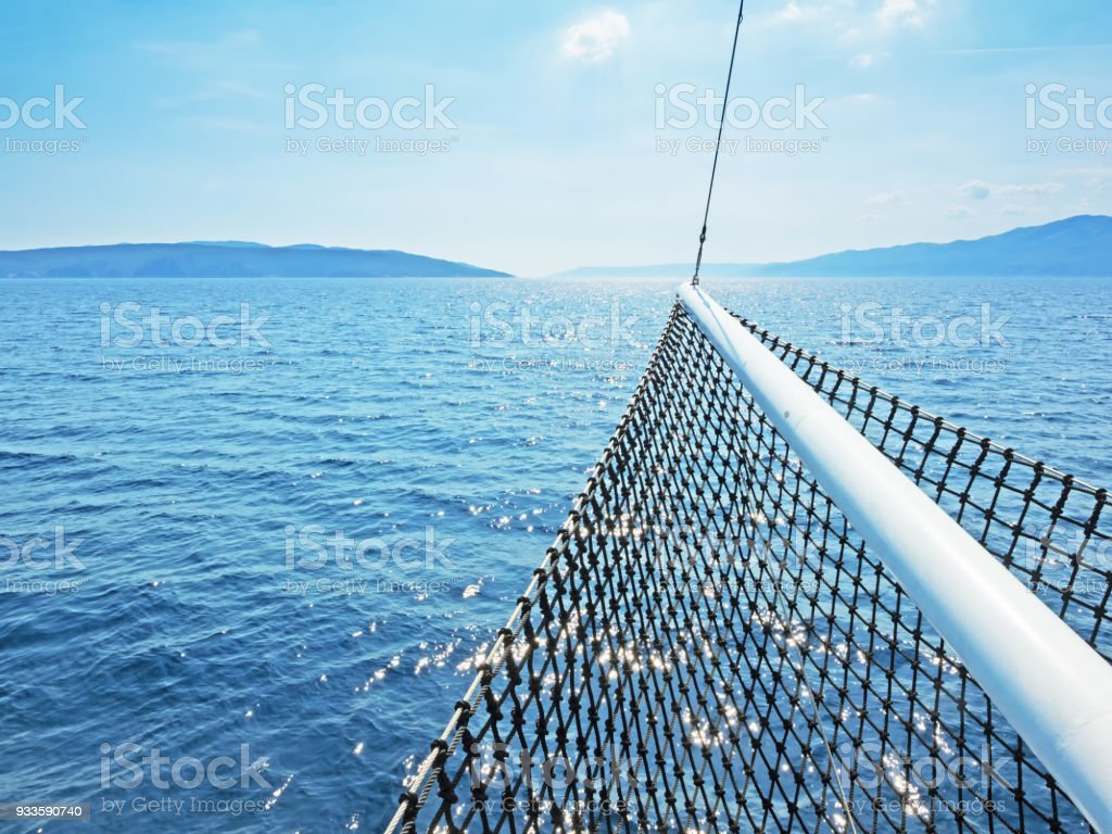Croatian islands in the Adriatic Sea with a ship's bow in the foreground stock photo
