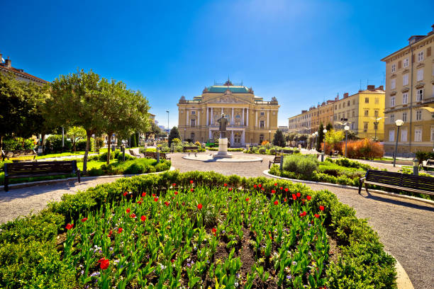 Croatian national theater in Rijeka square view, fountain and architecture, Kvarner bay, Croatia Croatian national theater in Rijeka square view, fountain and architecture, Kvarner bay, Croatia croatian culture stock pictures, royalty-free photos & images