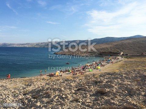Novalja, Croatia - July 29, 2018:Tourists and bathers enjoy the beaches and the sea of Croatia in Novalja on the island of Pag