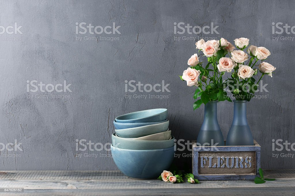 Crocery and roses bouquet stock photo