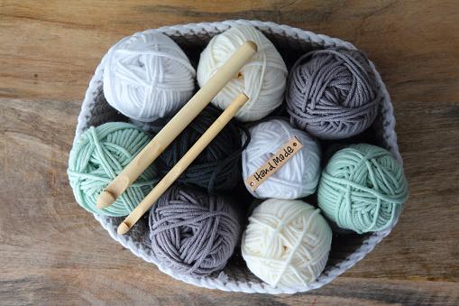 Crochet Basket With Balls Of Wool And Crochet Hooks