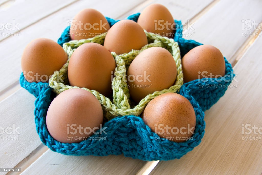 Crochet basket with eggs stock photo
