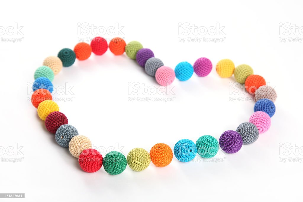 Crochet beads balls in form of heart royalty-free stock photo