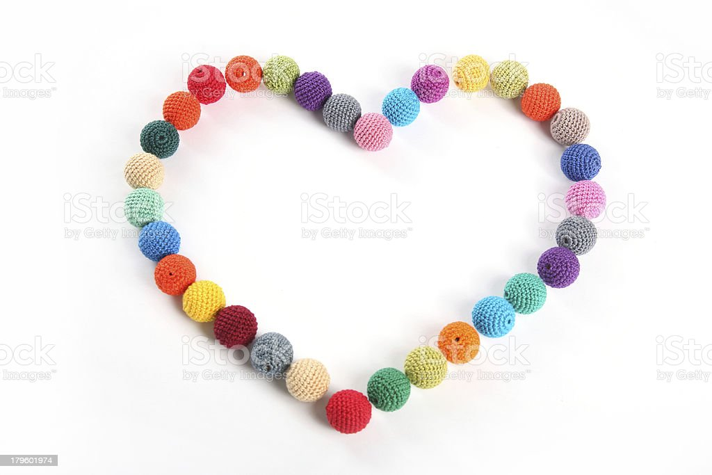 Crochet beads balls in form of heart top view royalty-free stock photo