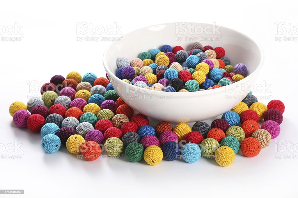 Crochet beads balls in white bowl side view royalty-free stock photo