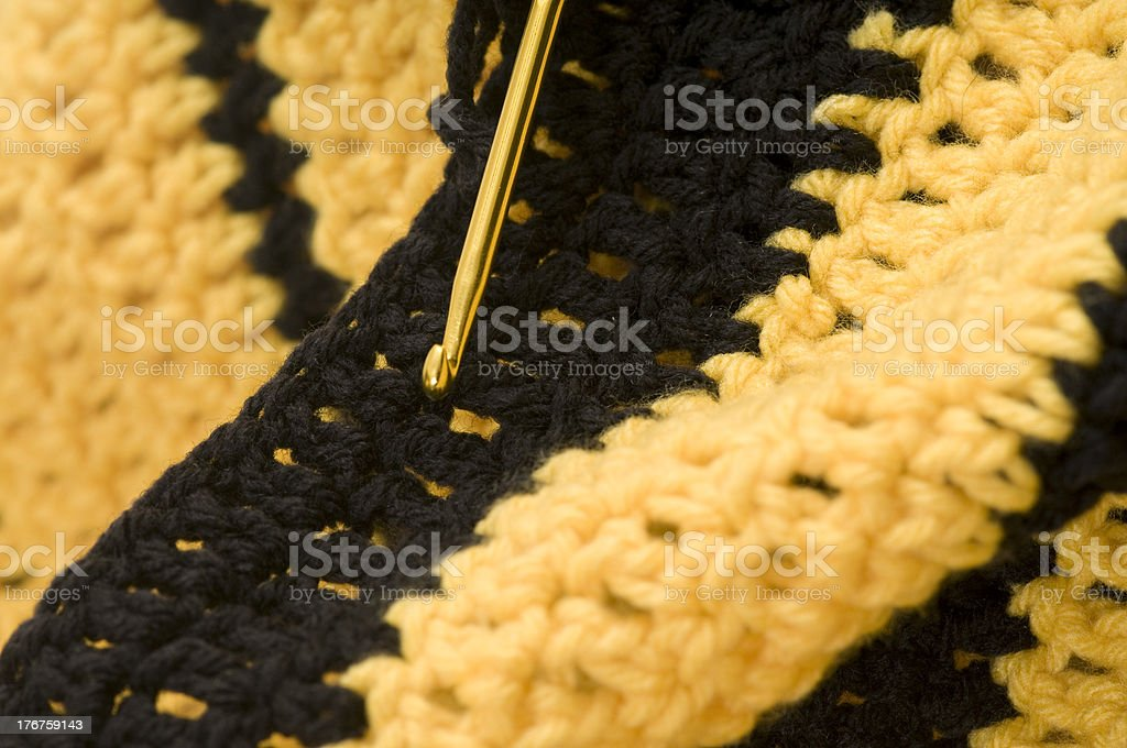 crochet black and gold stock photo