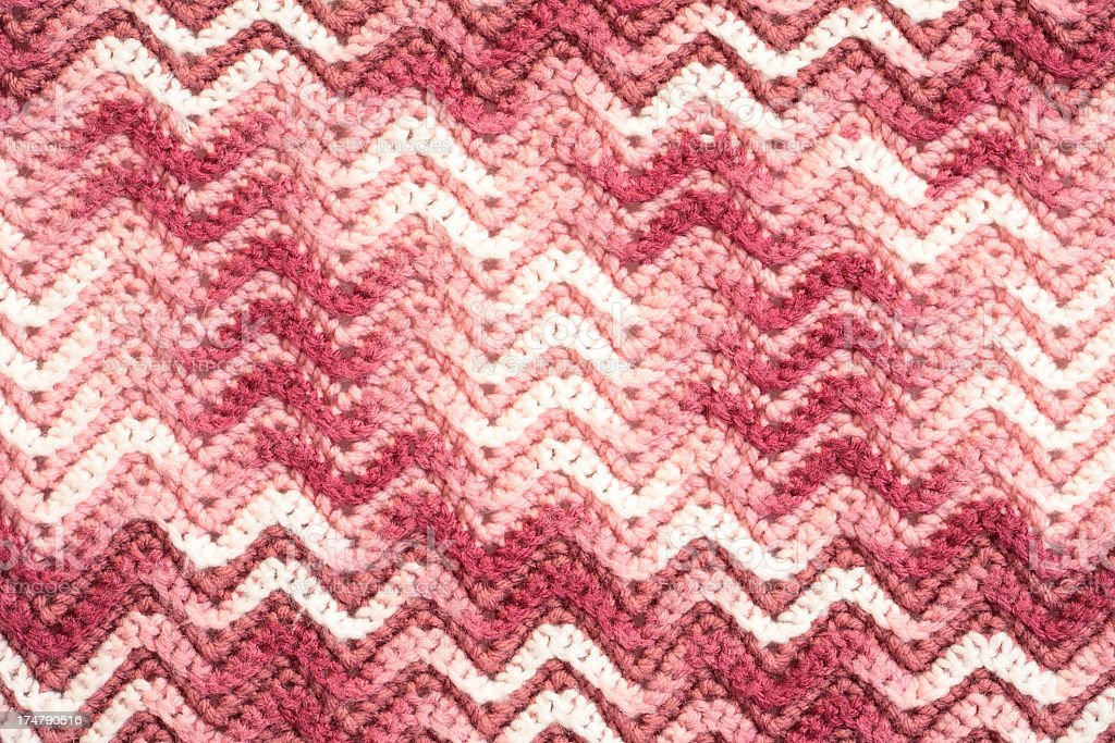Crochet blanket in pink with chevron pattern royalty-free stock photo