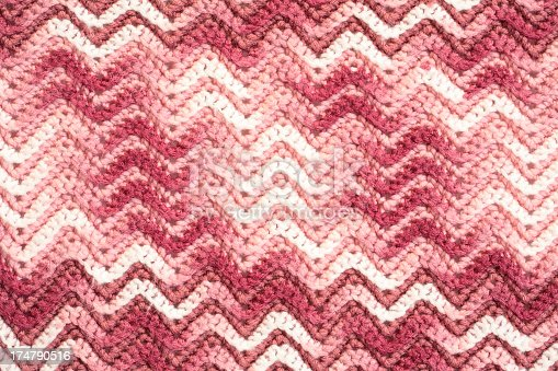 Crochet blanket in pink and white with chevron pattern