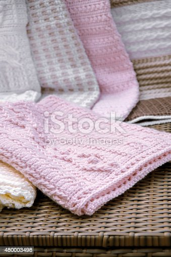 Crochet, Cable Knit Baby Blanket in Pink on Sofa with , Closeup High Contrast
