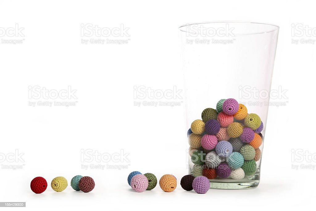Crochet colorful beads in glass vaze front view horizontal stock photo