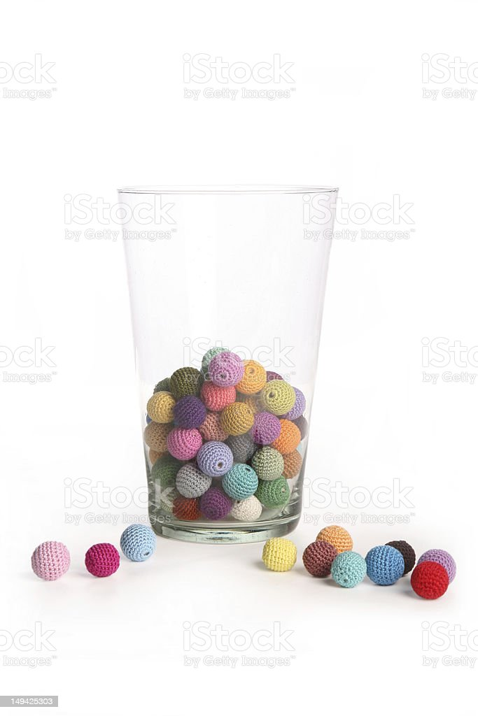 Crochet colorful beads in glass vaze front view on white stock photo