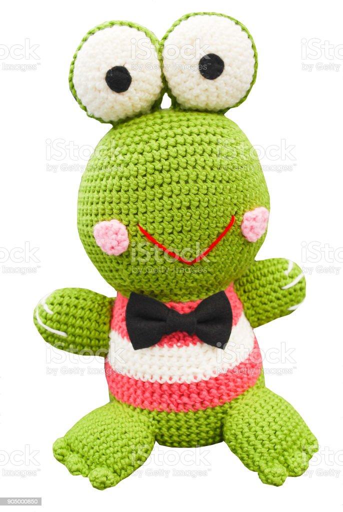 Muñeco rana verde hermosa sonriente en el estilo de animación japonesa de ganchillo - foto de stock