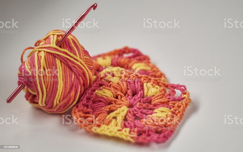 crochet granny squares with yarn and hook royalty-free stock photo