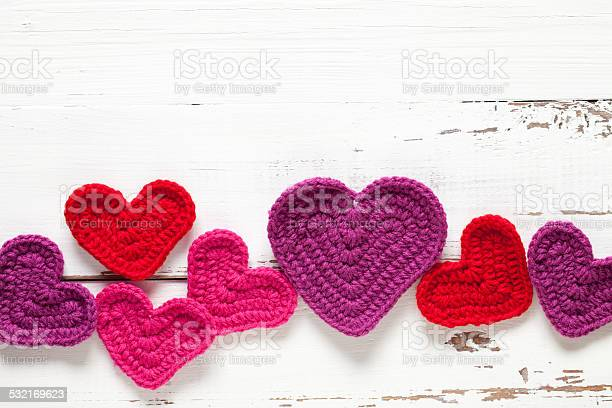 Crochet hearts on white table picture id532169623?b=1&k=6&m=532169623&s=612x612&h=5vokjna somfknwaluyw0k2j8qrviaz  rh0k dogh8=