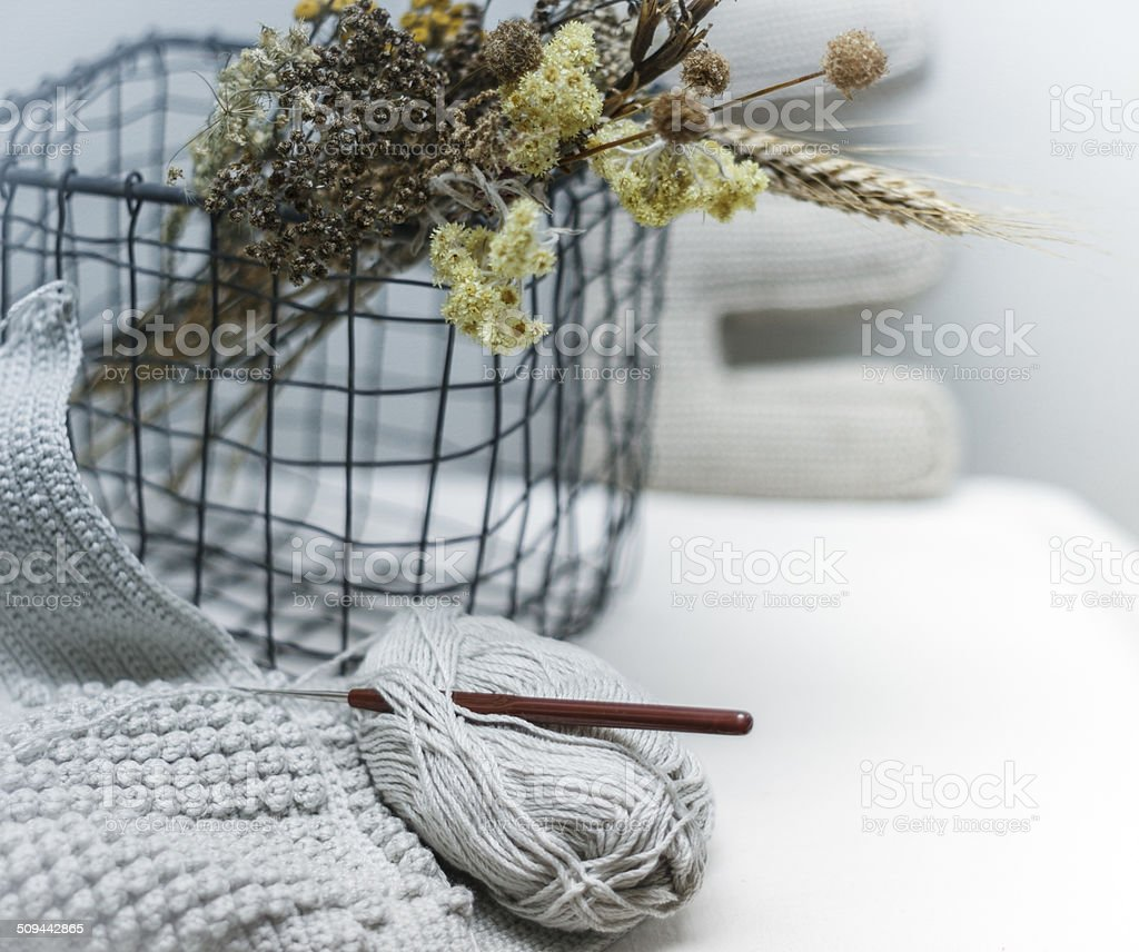 Crochet hook with yarn and cart stock photo