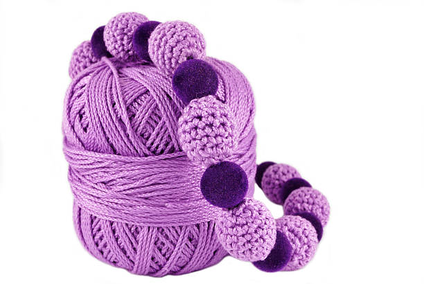 crochet jewelry -purple beads stock photo