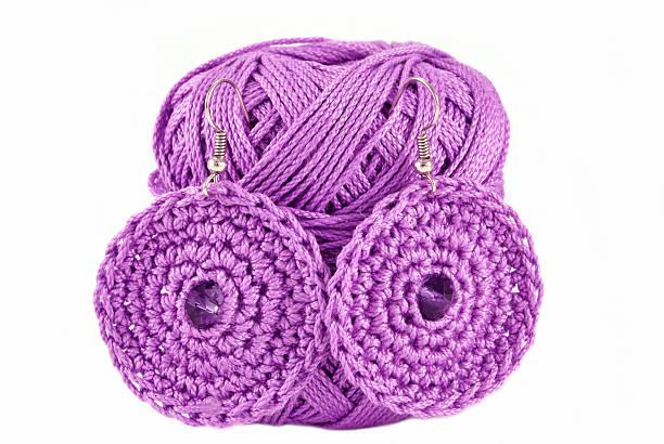 crochet jewelry - purple ear-rings stock photo