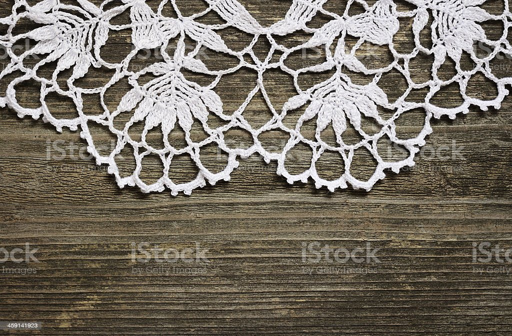 Crochet lace on wood royalty-free stock photo