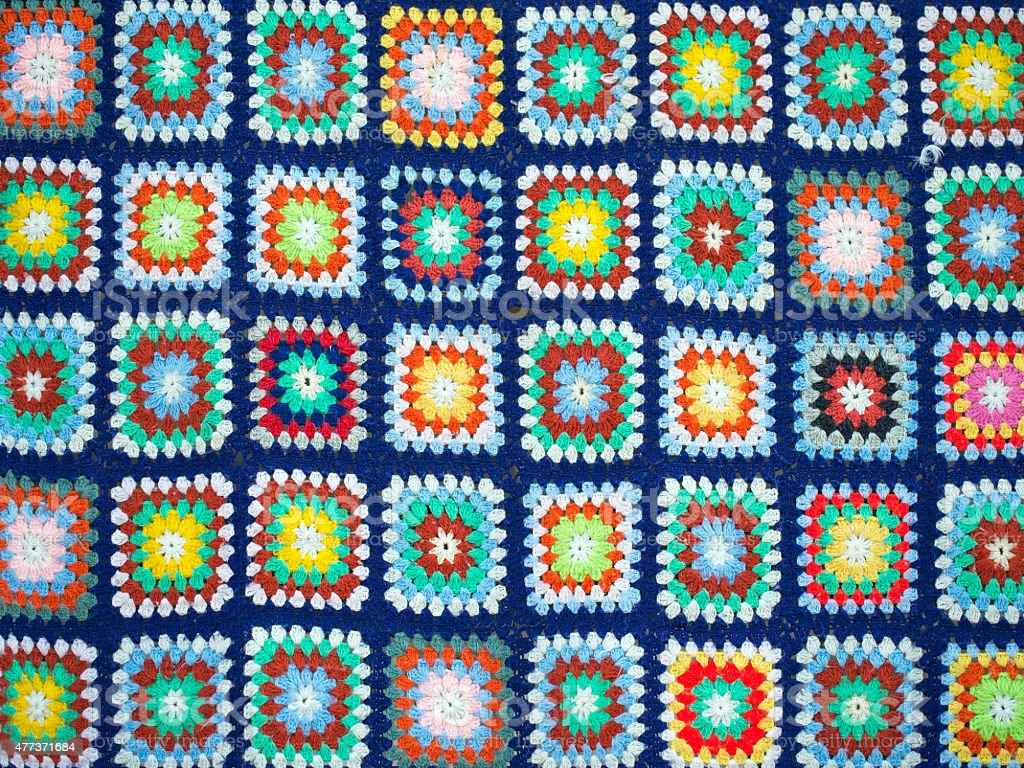 Crochet squares bright wool blanket stock photo