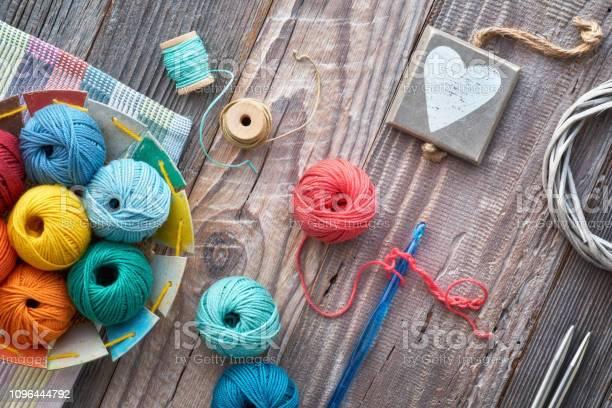 Crochet top view on yarn balls on rustic wood picture id1096444792?b=1&k=6&m=1096444792&s=612x612&h=zyctpchailjbp5drbqznj9o7hh1e5lhdz laajvrprq=