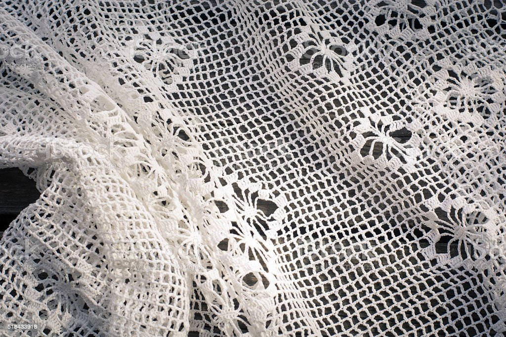 Crochet  white lace on wooden board stock photo
