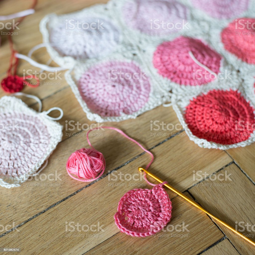 Crochet work over wooden floor stock photo