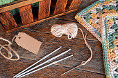 A top view image of crochet yarn and crochet hooks.