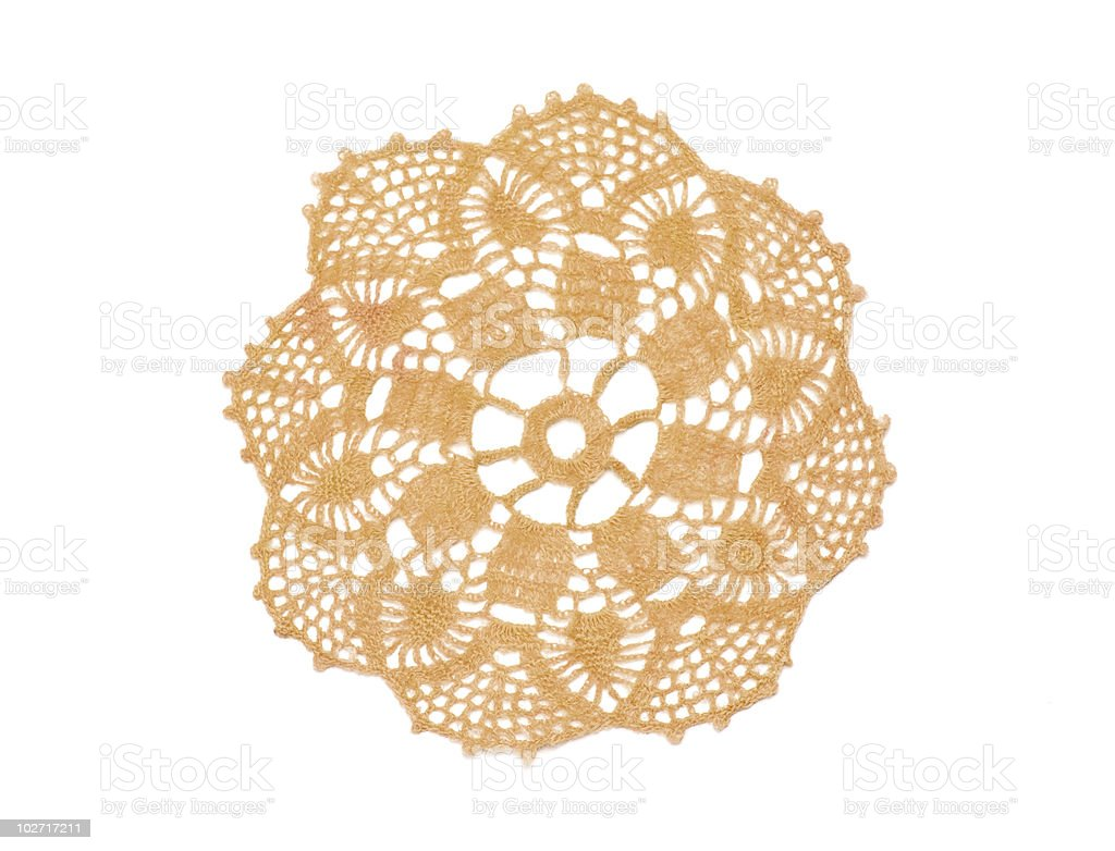 Crocheted beige doily royalty-free stock photo