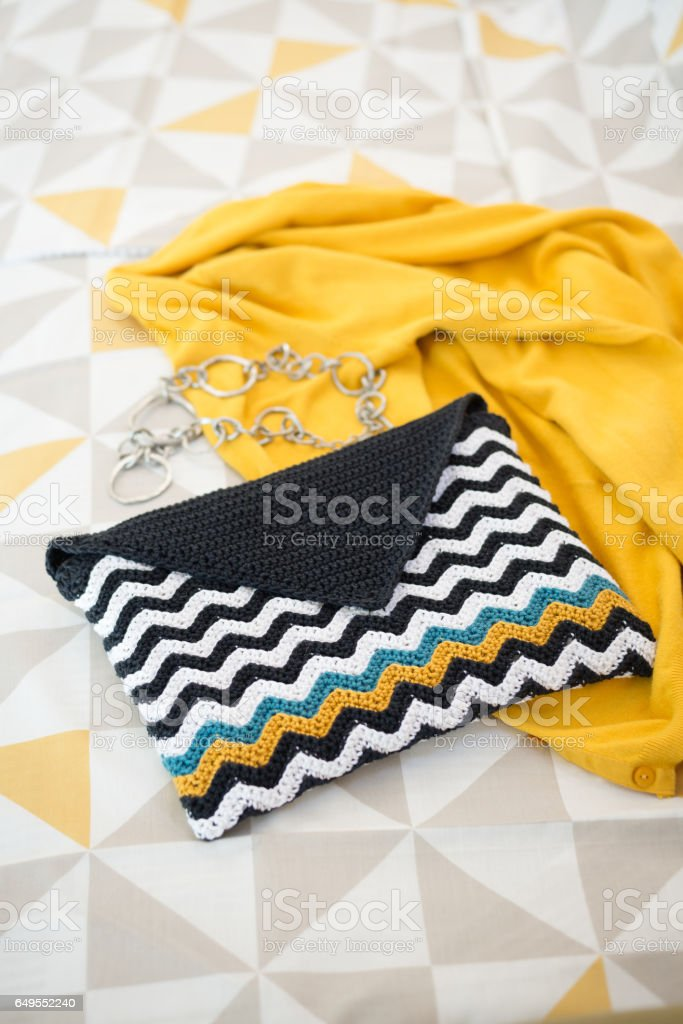 Crocheted Envelope-Style Pouch with Black and White Wave Pattern stock photo