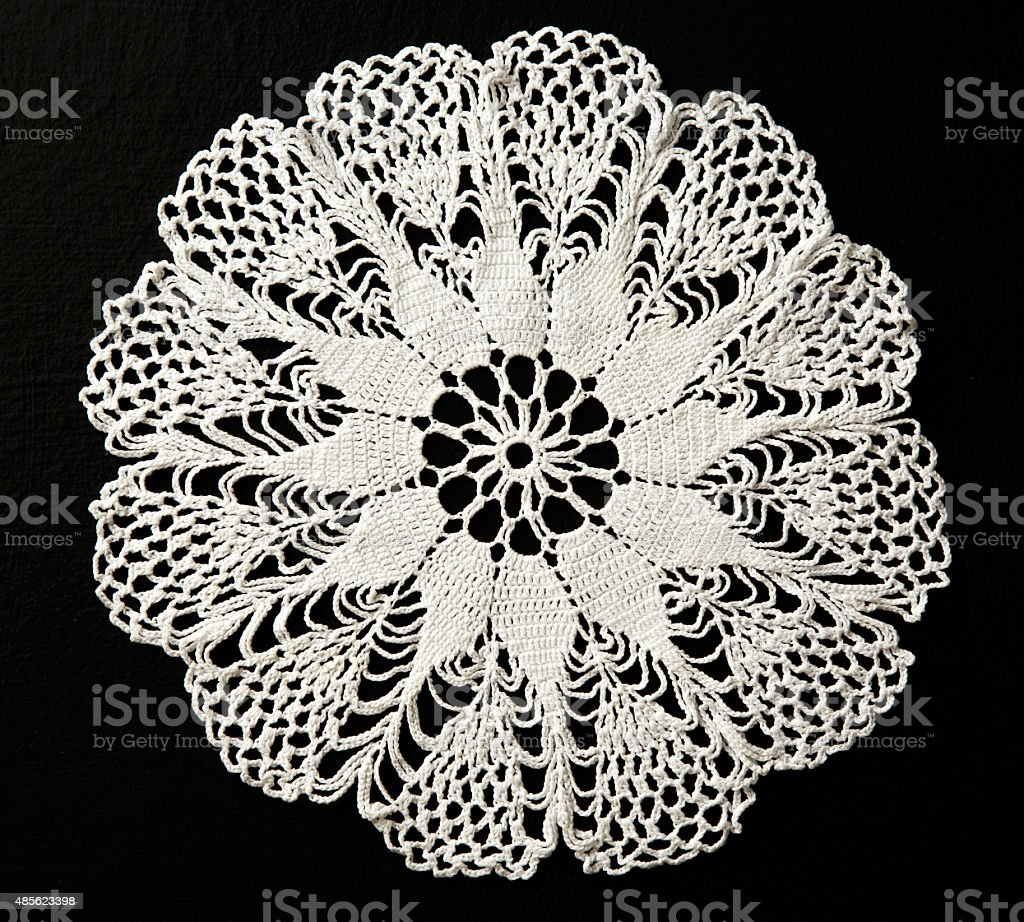 Crocheted lace napkin stock photo