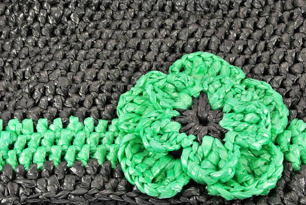 crocheted plastic bag decoratin stock photo