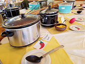 row of crock pots in chili cook-off contest