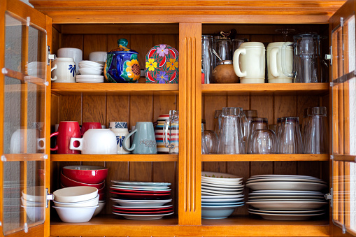 Crockery in the wooden cupboard