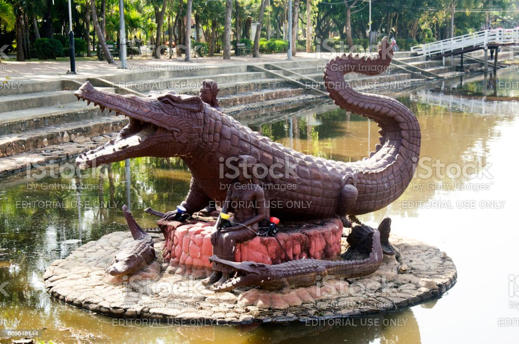 Crocodile statue name Chalawan at front at Bueng Si Fai stock photo