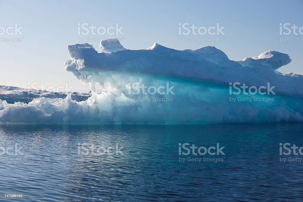 crocodile-shape iceberg stock photo