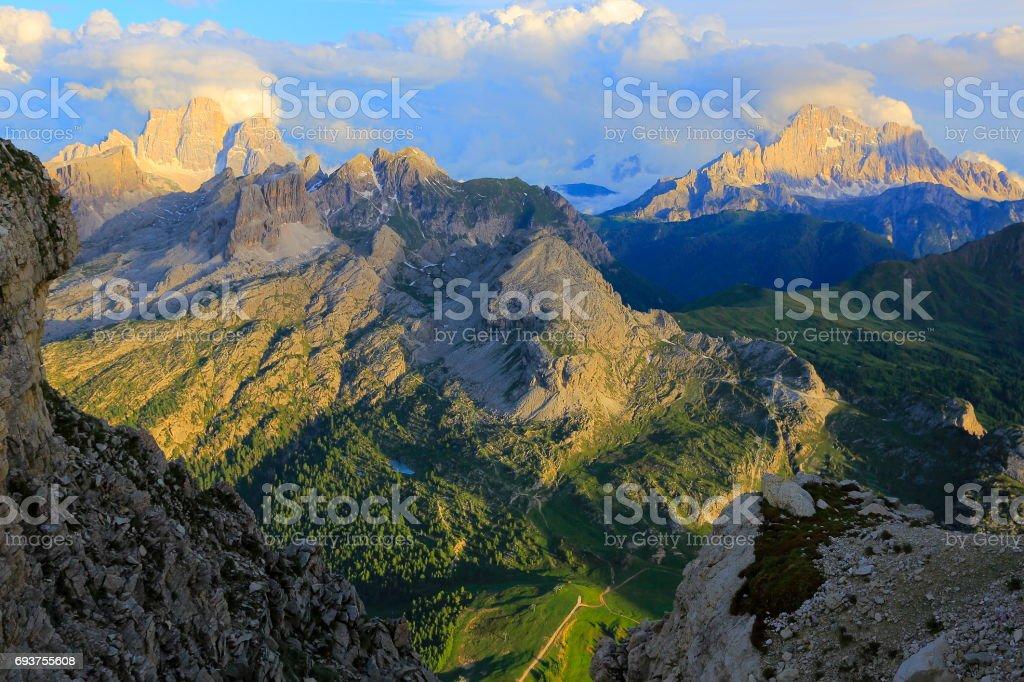 Croda da Lago and Mount Civetta at sunset, from Idyllic Lagazuoi summit panorama, Cinque Torri Dolomites, pinnacles mountain range, dramatic sky and majestic Italy tirol alps stock photo