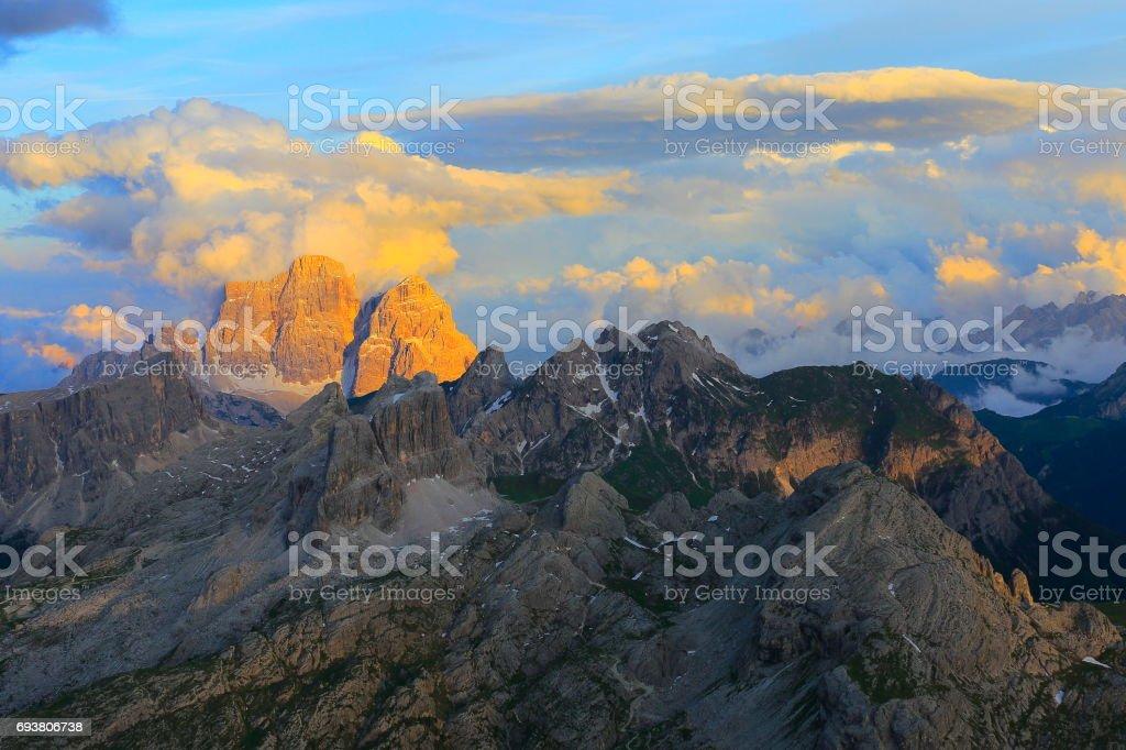 Croda da Lago at sunset, view from Idyllic Lagazuoi summit panorama, Cinque Torri Dolomites, pinnacles mountain range, dramatic sky and majestic Italy tirol alps stock photo