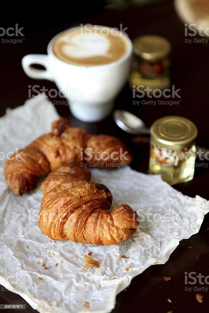 Croissant and a cup of delicous coffee royalty-free stock photo